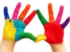 Children's hands painted in colour at a nursery