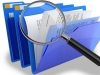 magnifying glass over files with primary school policies